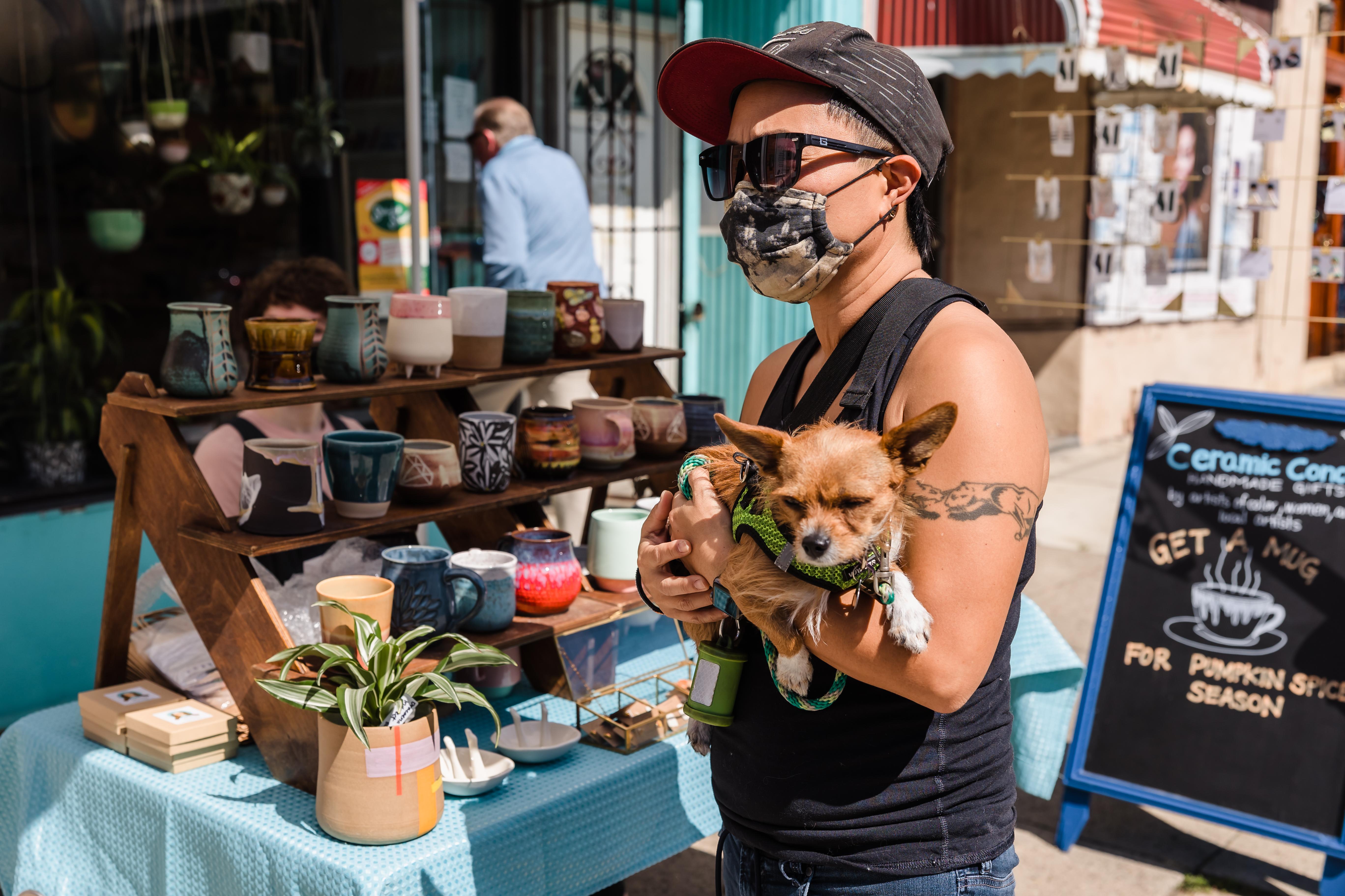 A neighbor and their dog visit VIX Emporium
