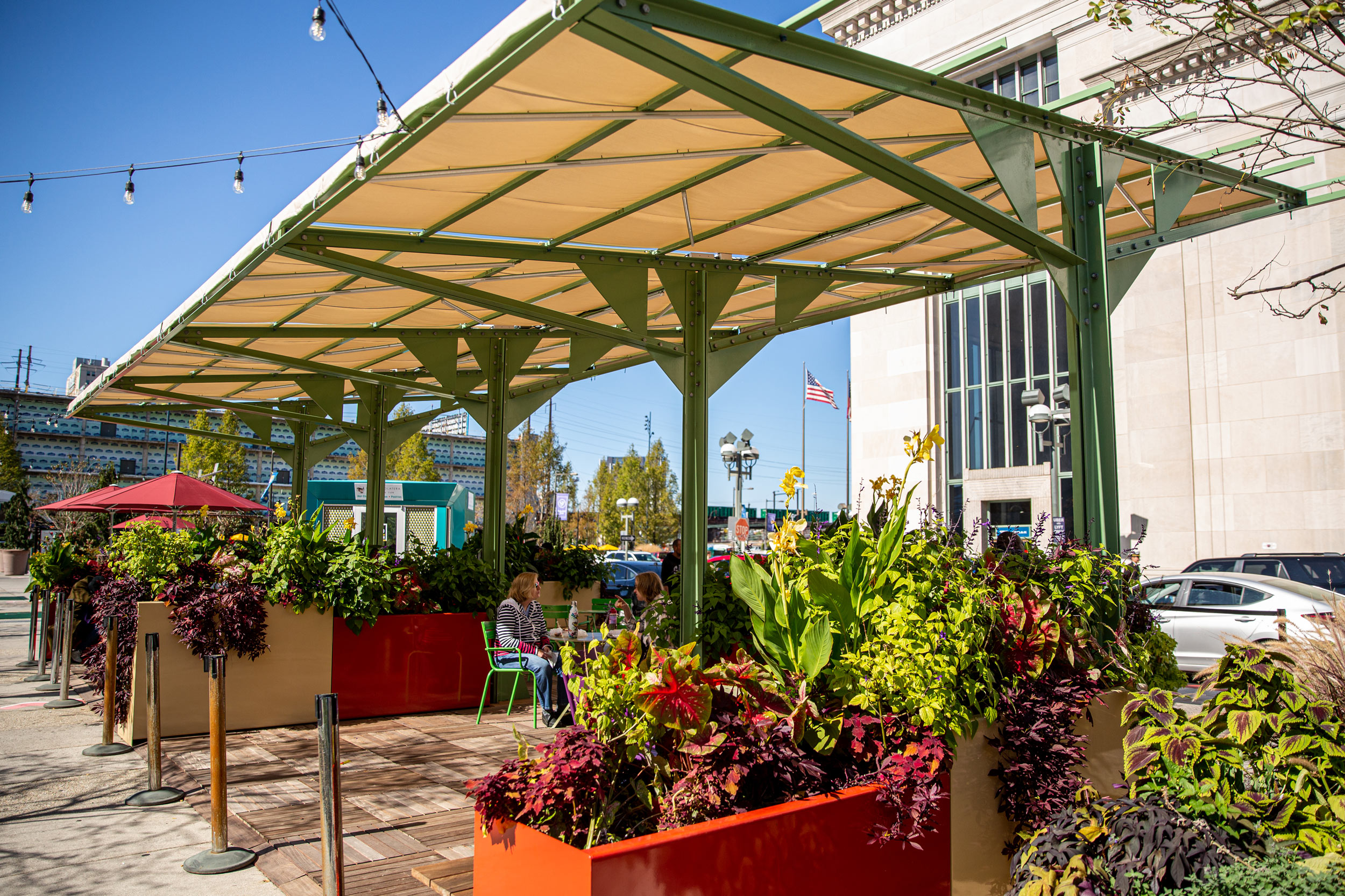 GCW installed wood decking, furniture, and tropical plantings for the new shade structure at the Porch at 30th Street Station, one of the public spaces that we maintain.