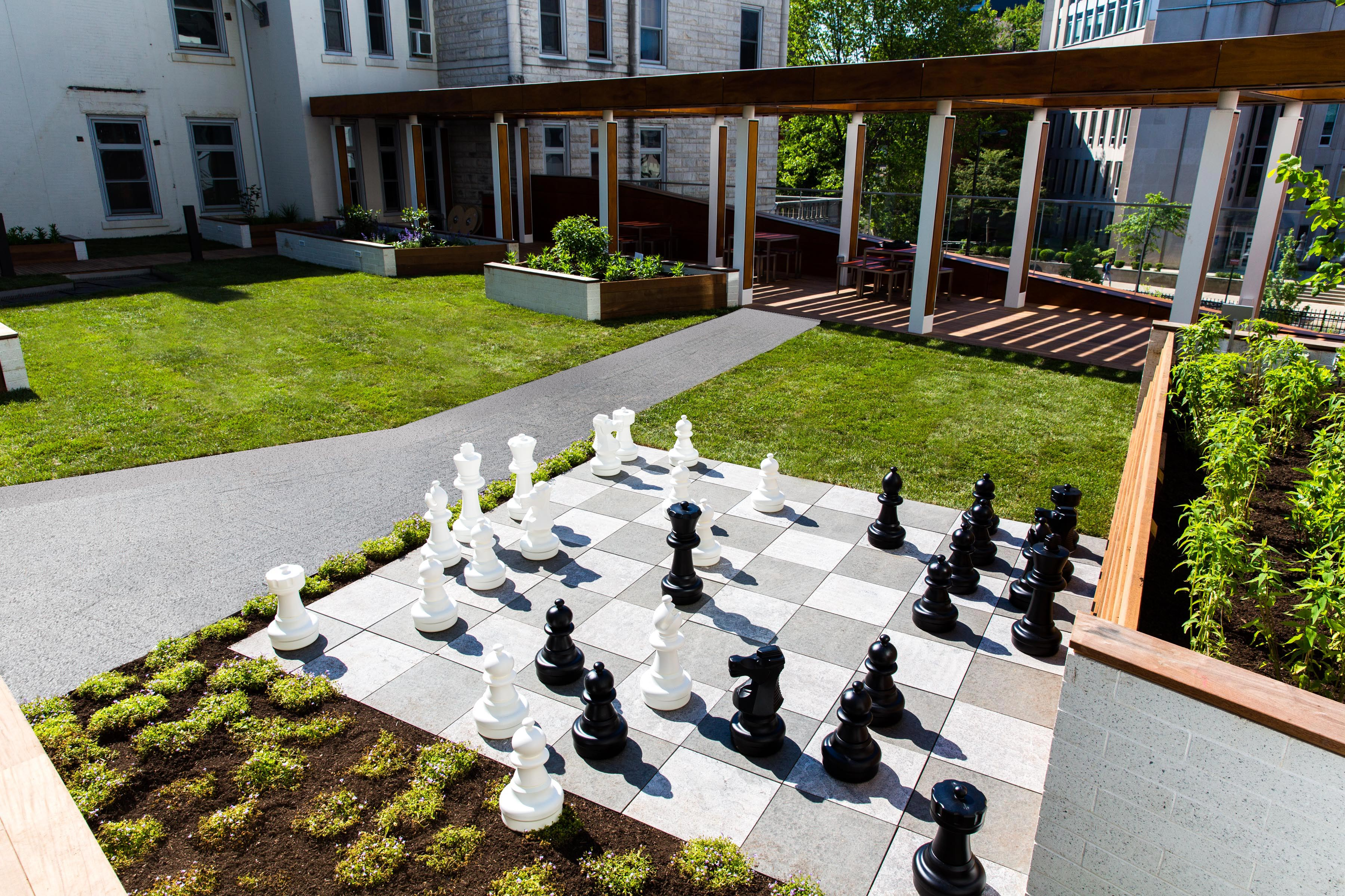 GCW created the planting design for the green roof and developed and installed a life-sized chess board made of natural stone pavers on a pedestal system.