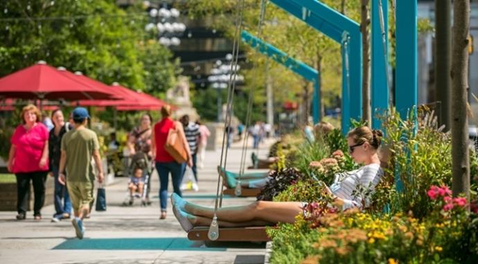 Visitors enjoy a swing at The Porch at 30th Street Station