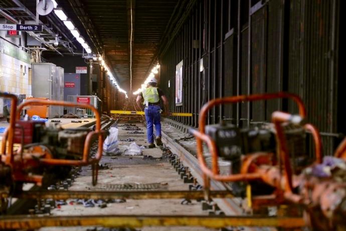 A SEPTA worker performing trolley track upkeep