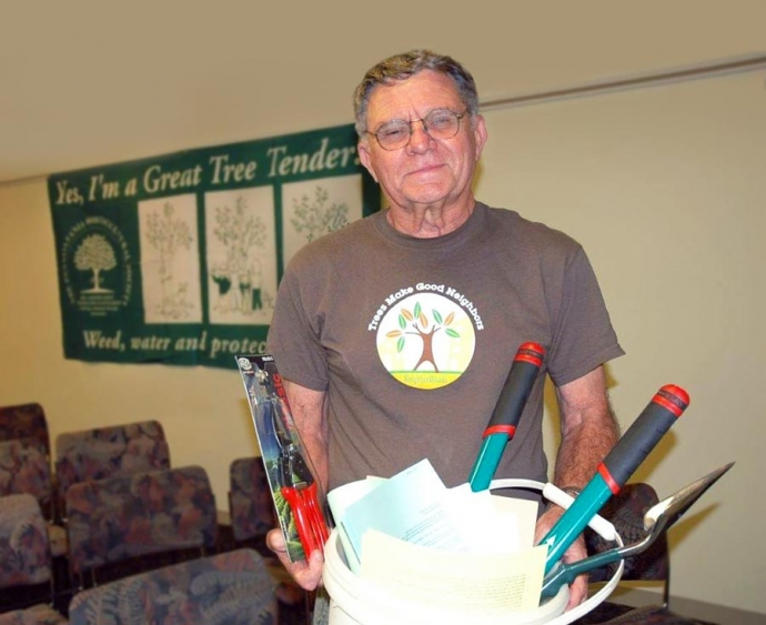Mike Hardy with a bucket of tree tending tools