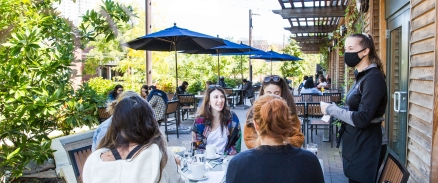 A group of diners enjoying a meal at Renata's Kitchen
