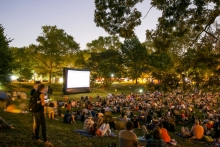 A crowd gathers in Clark Park for a movie night in 2016
