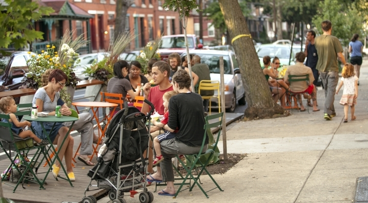 A family enjoying Popsicles at a UCD Parklet