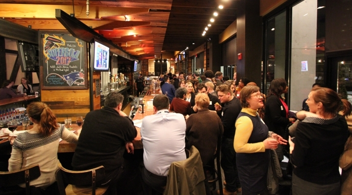 Local professionals network during University City MIX at City Tap House